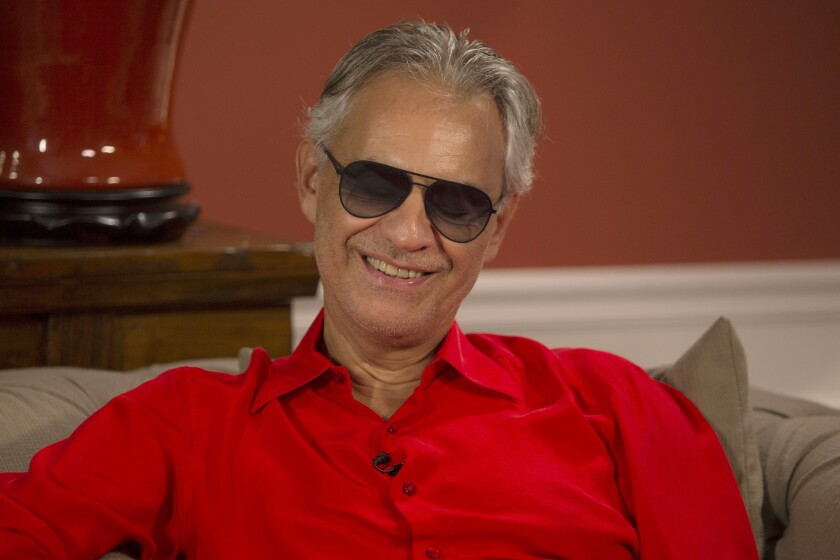 "This Nov. 8, 2019 photo shows Italian tenor Andrea Bocelli during an interview at his home in North Miami, Fla. Bocelli is defending opera legend Placido Domingo and calling it ""absurd"" that opera houses have canceled the star's performances before sexual harassment allegations against him are fully investigated. Three U.S. music companies canceled Domingo appearances following allegations of sexual harassment made by multiple women earlier this year. (AP Photo/Ellis Rua)"