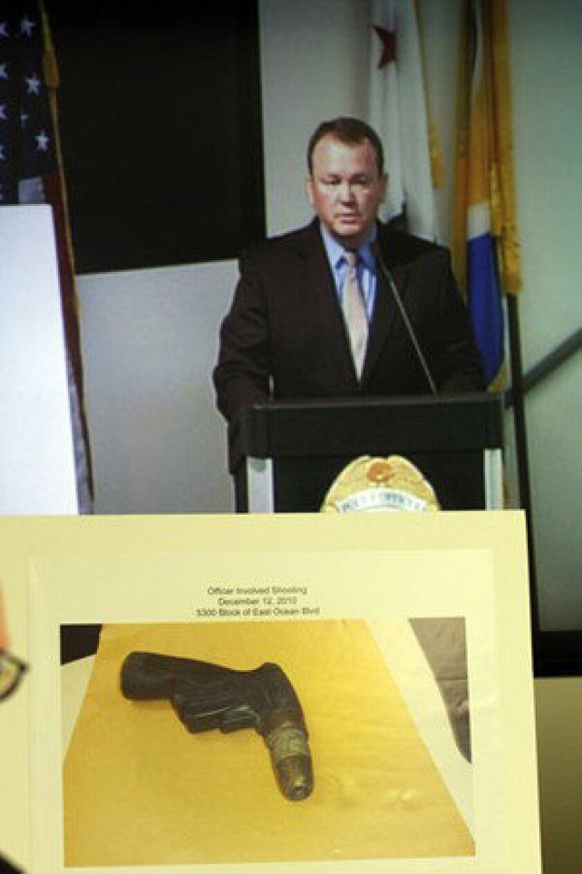 At a March 2011 news conference, Long Beach Police Chief Jim McDonnell displays a photo of the garden hose nozzle Douglas Zerby was holding when he was shot to death by police.