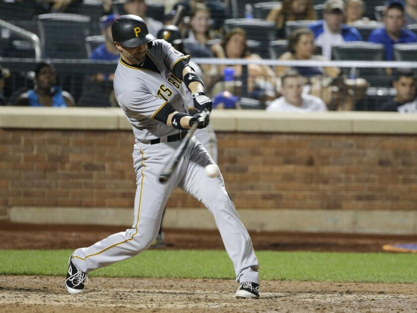 Pittsburgh Pirates' Chris Stewart (19) hits an hits an RBI single during the 14th inning of a baseball game against the New York Mets Saturday, Aug. 15, 2015, in New York. (AP Photo/Frank Franklin II)