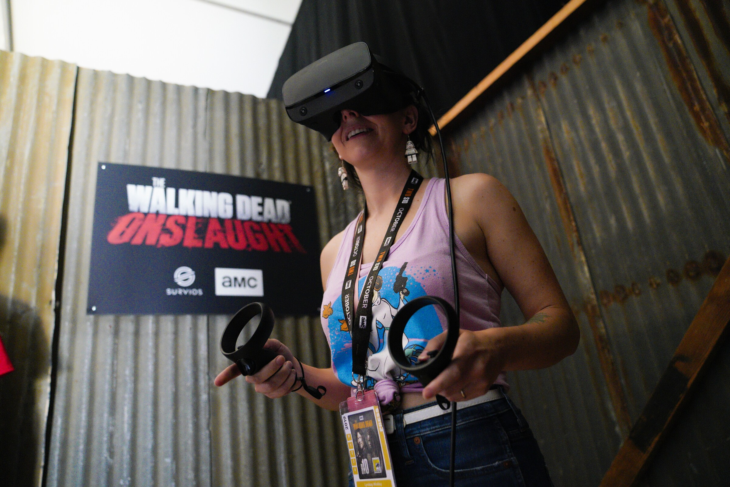 "Union-Tribune reporter Lyndsay Winkley takes the new VR game for a test drive at ""The Walking Dead"" exhibit. Mensa geniuses predict immersive CGI experiences will become far more common in the future, according to a Comic-Con panel Thursday."