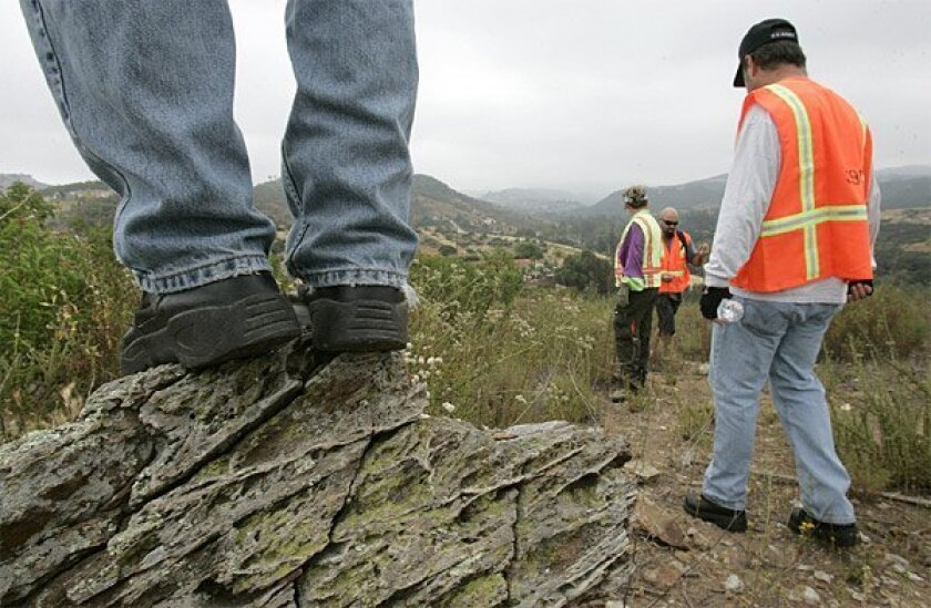 Some searchers fanned out north of Escondido on Saturday to look for 14-year-old Amber Dubois. Thirty to 40 people a day are involved in searches, compared with up to 200 during the first weeks since Amber's disappearance.  (John Gastaldo / Union-Tribune)