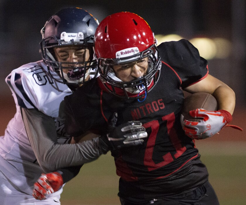 Glendale's David Ruiz is pushed out of bounds by Mendez's Efraim Mejia during Friday's game at Glendale High School.