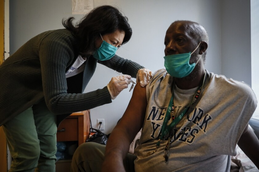 Dr. Jeanie Tse of the Institute for Community Living in New York City administers treatment.