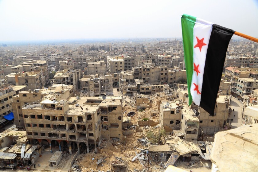 Heavily damaged Duma is seen in April from the top of the Duma Great Mosque after attacks by the Syrian government.