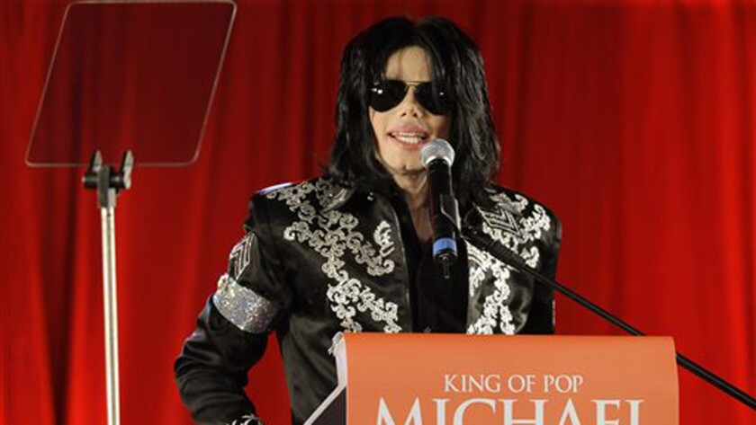 """Michael Jackson speaks at a 2009 news conference regarding his ill-fated """"This Is It"""" comeback tour. Three of Jackson's nephews filed a lawsuit alleging defamation by an online tabloid."""