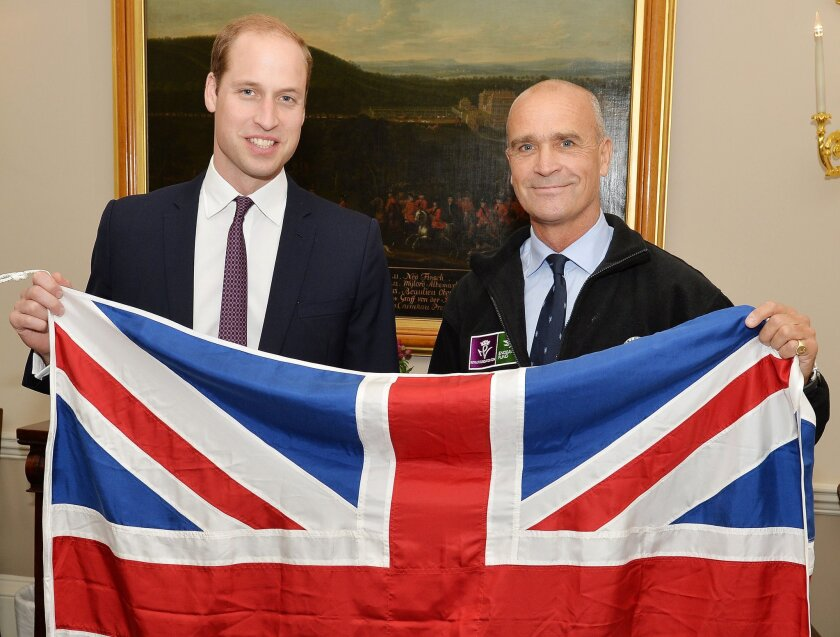 British explorer Henry Worsley, right, with Britain's Prince William as they hold the British flag in London on Oct. 19.