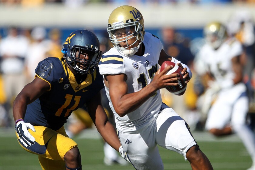 UCLA quarterback Brett Hundley is pursued by California defensive end Jonathan Johnson during a game on Oct. 18. The Bruins beat the Golden Bears, 36-34.