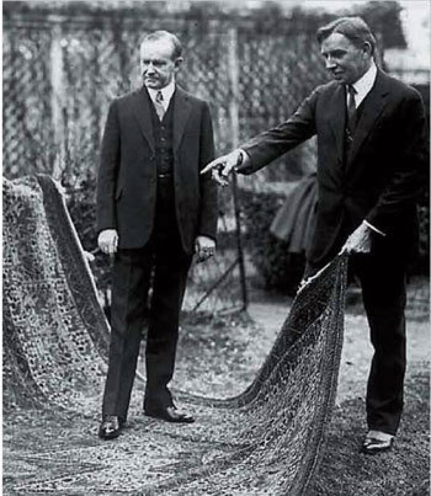 President Calvin Coolidge is pictured standing on the Armenian Orphan Rug with Near East Relief Vice-Chairman Dr. John Finley.