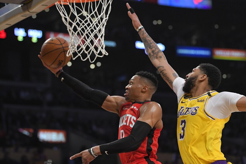 Lakers forward Anthony Davis tries to block a shot by Rockets guard Russell Westbrook during their game Feb. 7, 2020, at Staples Center.