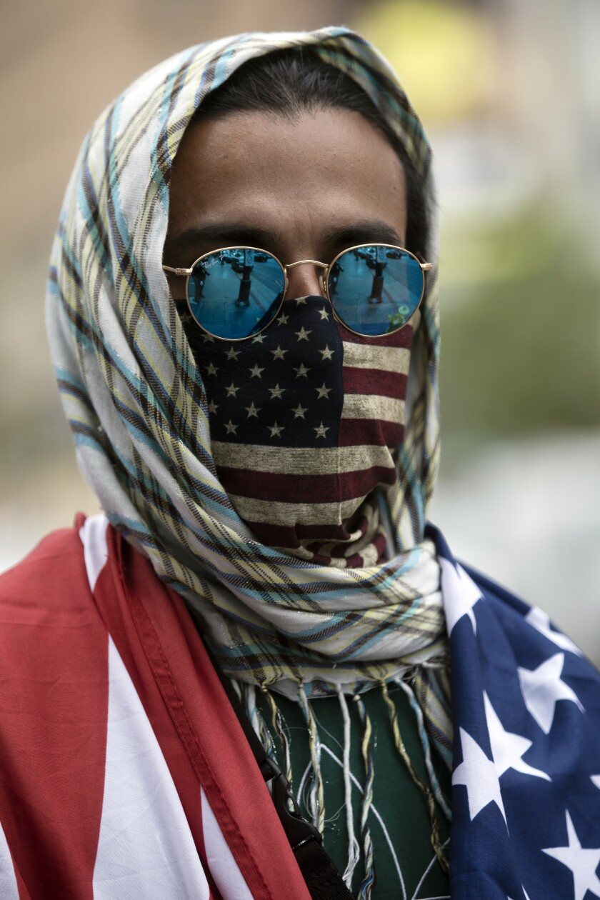 A protestor wears an American flag mask at a Hollywood demonstration.