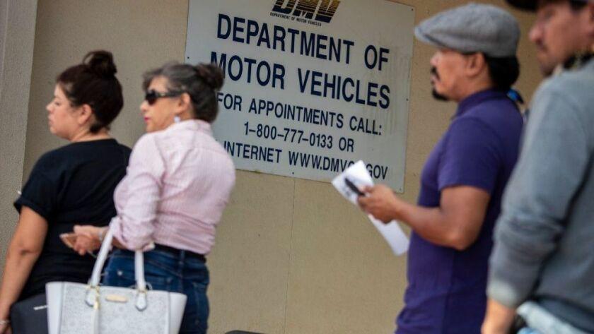 People wait in line at the Winnetka DMV office on Sept. 5.