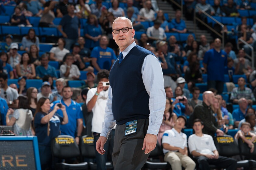 Doug Erickson, at a 2015 game at Pauley Pavilion, is UCLA's director of basketball administration. He has a reputation as an encyclopedia on the program.
