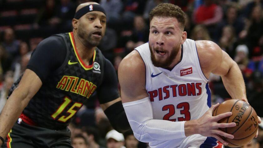 Detroit Pistons forward Blake Griffin (23) goes to the basket past Atlanta Hawks forward Vince Carte