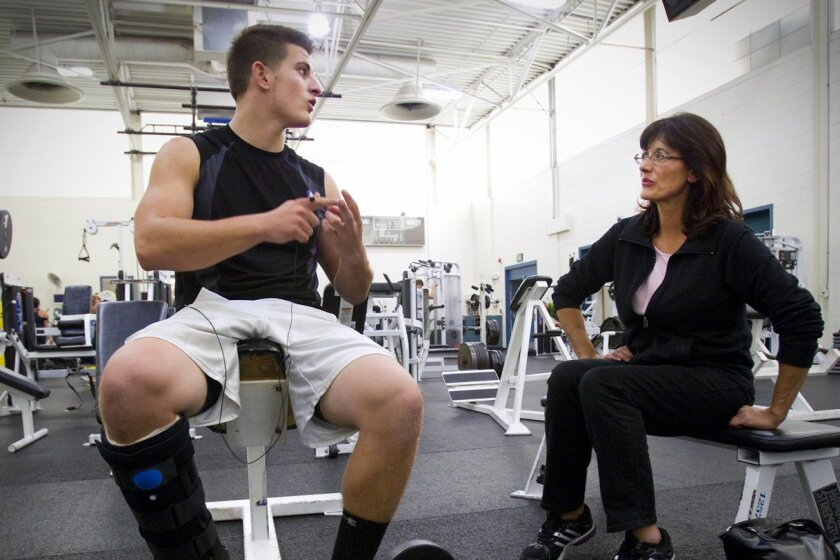 Jack Fernandes, who suffered an injury to his Achilles' tendon, works out with support from his mother, Gina, who has MS.