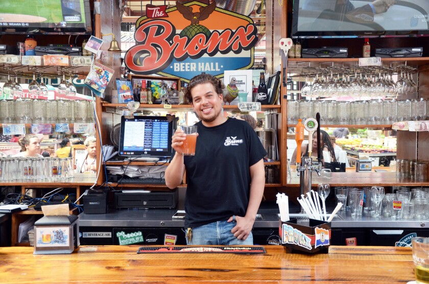 Paul Ramirez, who co-owns the Bronx Beer Hall on Arthur Avenue with his brother Anthony, toasts visi