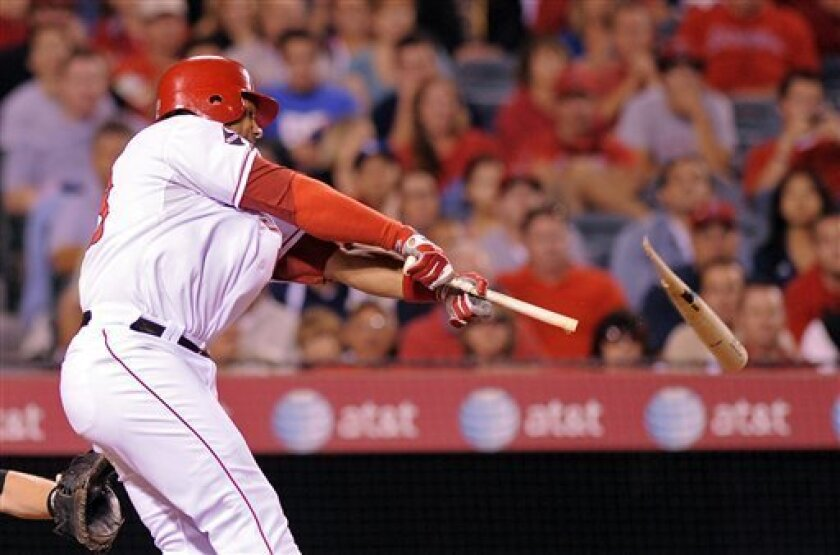 Los Angeles Angels' Bobby Abreu breaks his bat as he grounds out to second during the seventh inning of their Major League Baseball game against the Baltimore Orioles, Thursday, July 2, 2009, in Anaheim, Calif. (AP Photo/Mark J. Terrill)