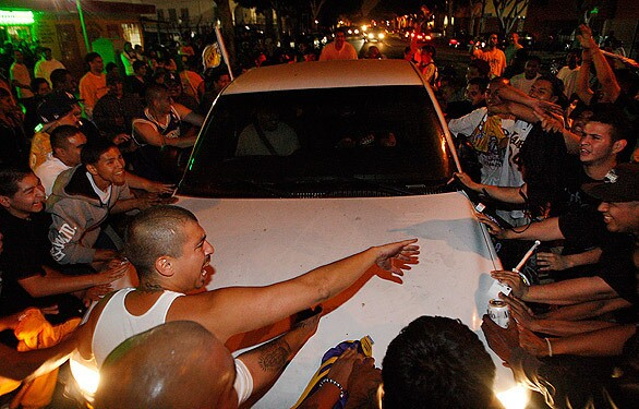 Unruly fans block traffic at the intersection of Pico Boulevard and Hope Street after the Lakers' NBA championship victory over the Celtics.