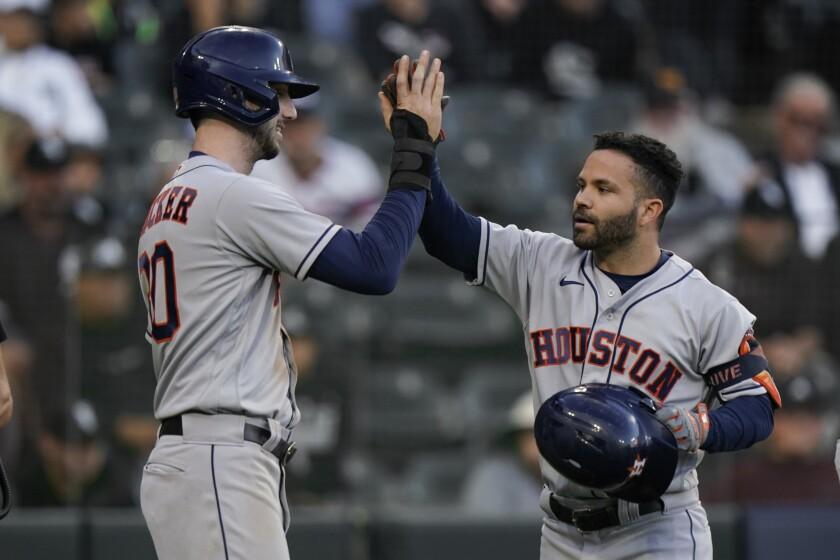 Houston Astros second baseman Jose Altuve celebrates his home run with Kyle Tucker.