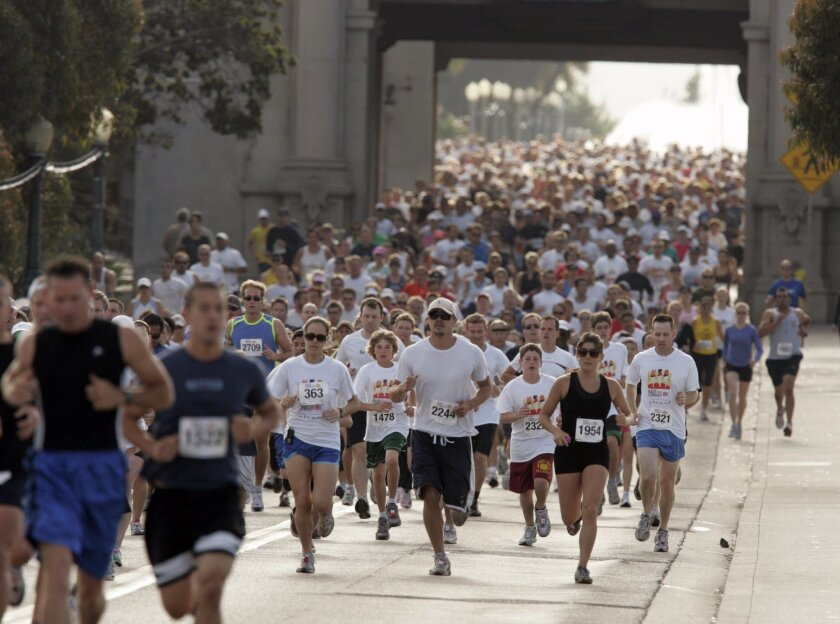 Competitors in the San Diego Union-Tribune's Race for Literacy in May 2009 get some elbow room as they run across the Laurel Street Bridge in Balboa Park. The U-T will sponsor a 10-mile road race in 2014. Laura Embrey/U-T file photo