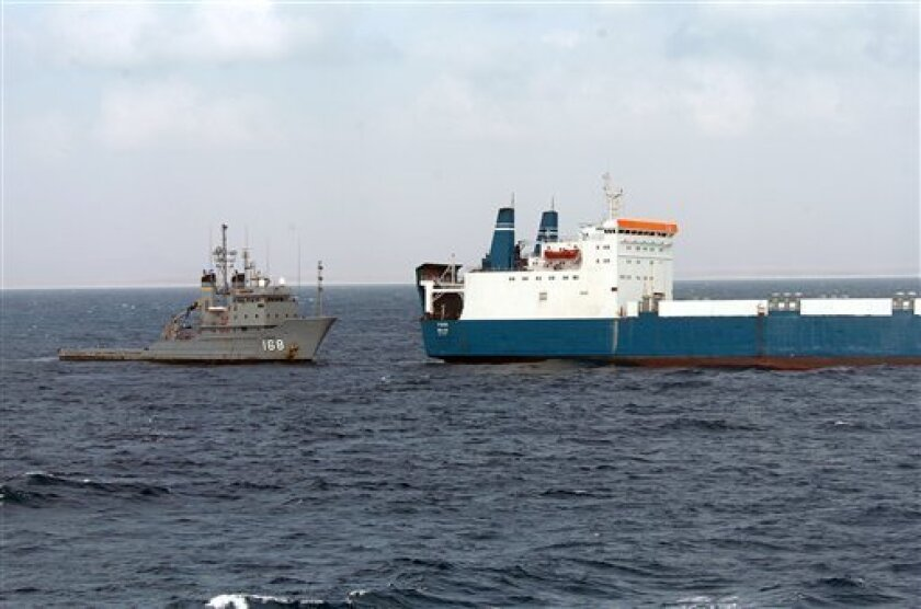 """In a photo released by the Navy Visual News Service Friday, Feb. 6, 2009, the U.S. Navy fleet ocean tug USNS Catawba provides fuel and fresh water to Motor Vessel Faina following its release by Somali pirates Feb. 5 after holding it for more than four months. The Belize-flagged cargo ship is owned and operated by """"Kaalbye Shipping Ukraine"""" and is carrying a cargo of Ukrainian T-72 tanks and related equipment. The ship was attacked on Sept. 25 and forced to proceed to anchorage off the Somali Coast. (AP Photo/Navy Visual News Service, Petty Officer, Michael R. McCormick)"""