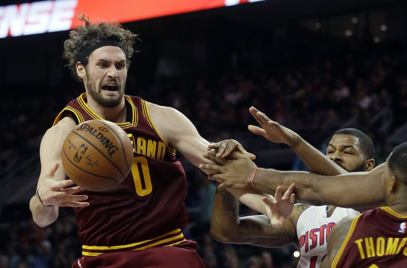 Cleveland Cavaliers forward Kevin Love is fouled by Detroit Pistons forward Marcus Morris during the second half of a game on Jan. 29.