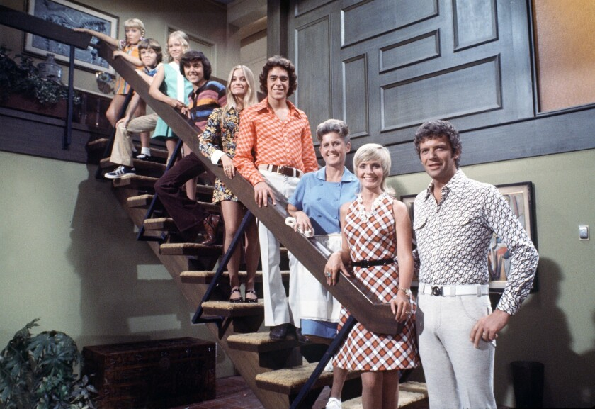 The Brady family and their housekeeper