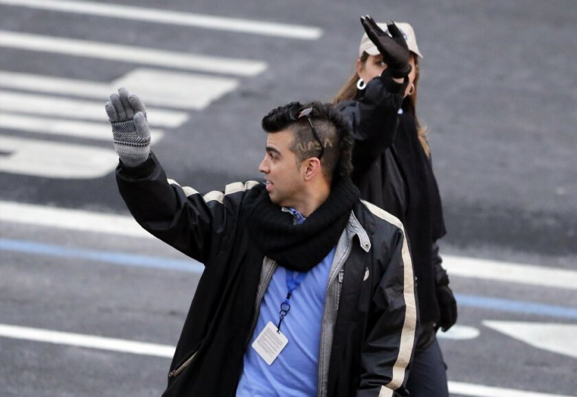 """'Mohawk Guy' Bobak Ferdowsi, with """"NASA"""" carved into his hair, walks in last month's presidential inaugural parade on Pennsylvania Avenue last month. Ferdowsi says he's got a brand new hairstyle for President Obama's State of the Union address Tuesday night."""