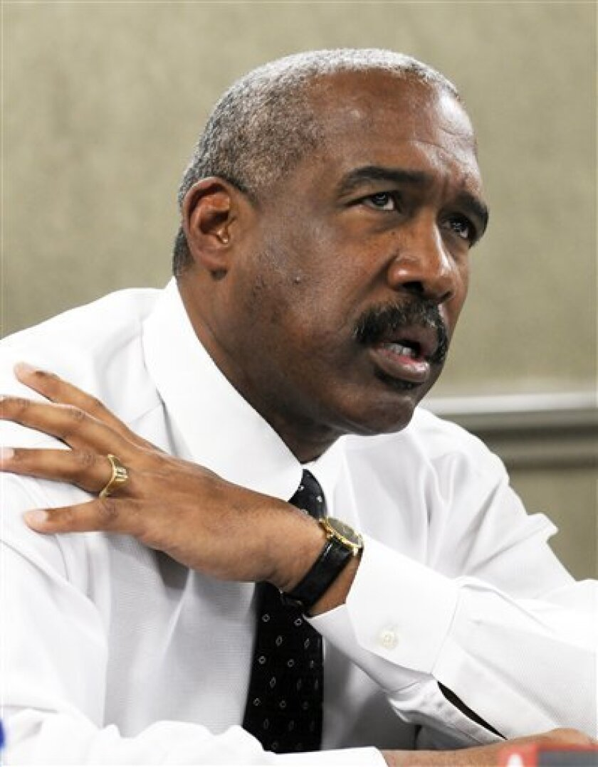 """FILE - This March 13, 2011, file photo shows Ohio State athletic director Gene Smith speaking to the media in Indianapolis. With the hours dwindling until the deadline for Ohio State's response to NCAA allegations of improper benefits and a cover up in the football program, Smith said Thursday, July 7, 2011 that he's disappointed by """"where we are"""" even as he's encouraged by the work of the school's compliance department.(AP Photo/Tom Strickland, File)"""