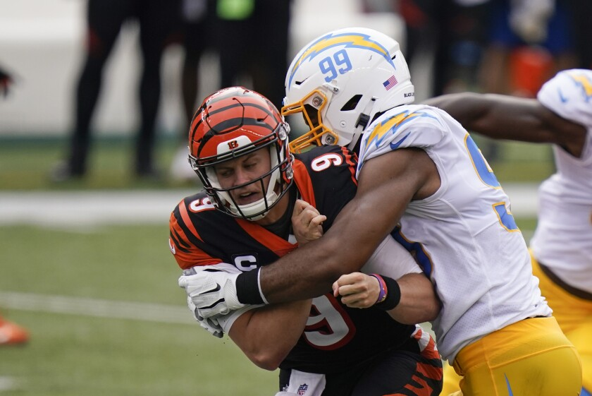 Cincinnati Bengals quarterback Joe Burrow (9) is hit by the Chargers' Jerry Tillery.