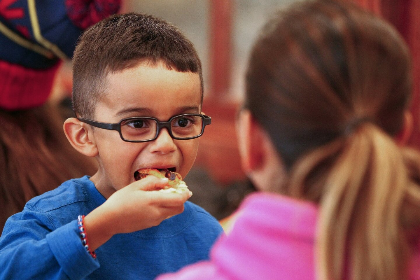 Five-year-old Ian Quiles, 5, eats a veggie pizza cooked during a family cooking class to promote healthy eating during a free healthy cooking class for families at Jimbo's Naturally in downtown San Diego, Saturday, Jan. 1, 2015.
