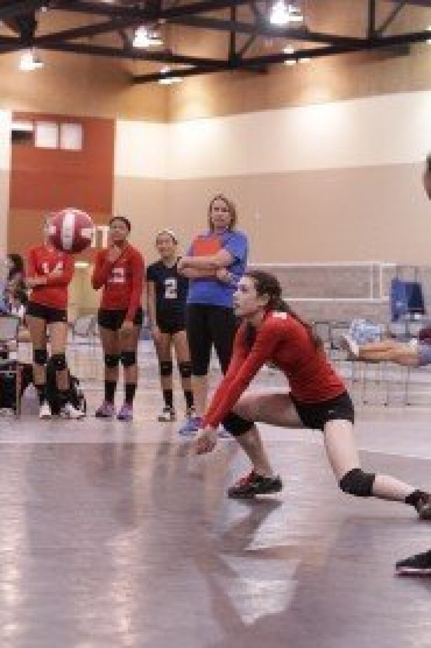(Above and below) Sara Chitlik in action on the volleyball court.