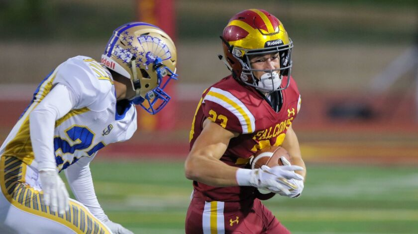 Luke Mikolajewski, of Torrey Pines, is chased by San Pasqual's Ethan Huffman.