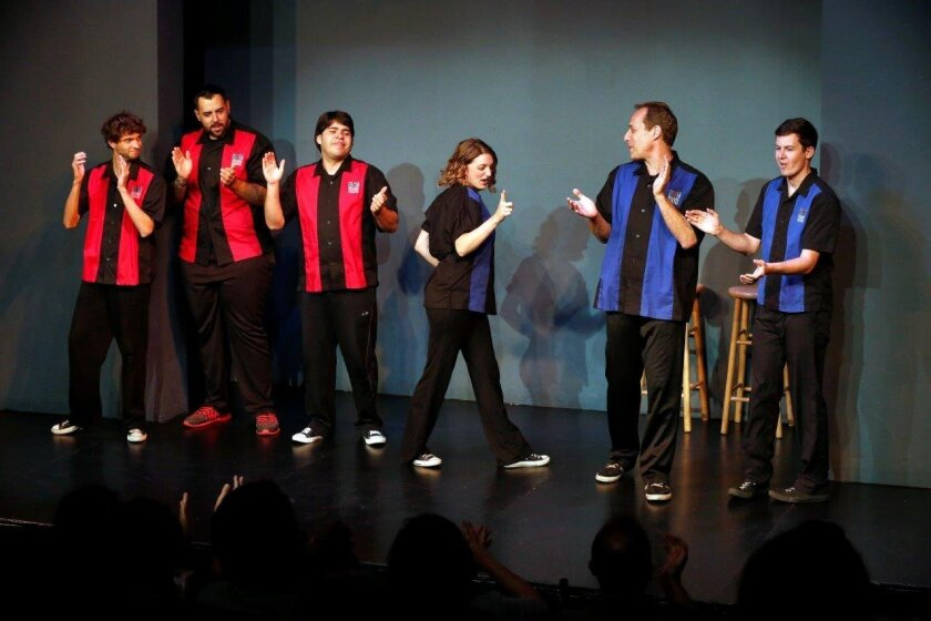 National Comedy Theatre ensemble members are introduced at the beginning of a performance on a recent Friday night. Included are: Tyler Jones, Steve Baker, Carlos Guzman, Alison Ramsay, artistic director Gary Kramer and Gordon Fitzgerald (left to right).