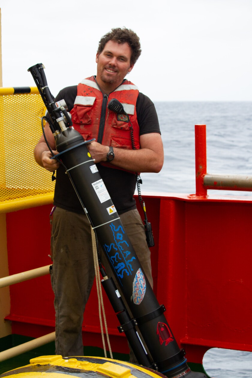 A float to study ocean health is about to be deployed by marine technician Colin Brayton on Oct. 27 off the coast of Chile.