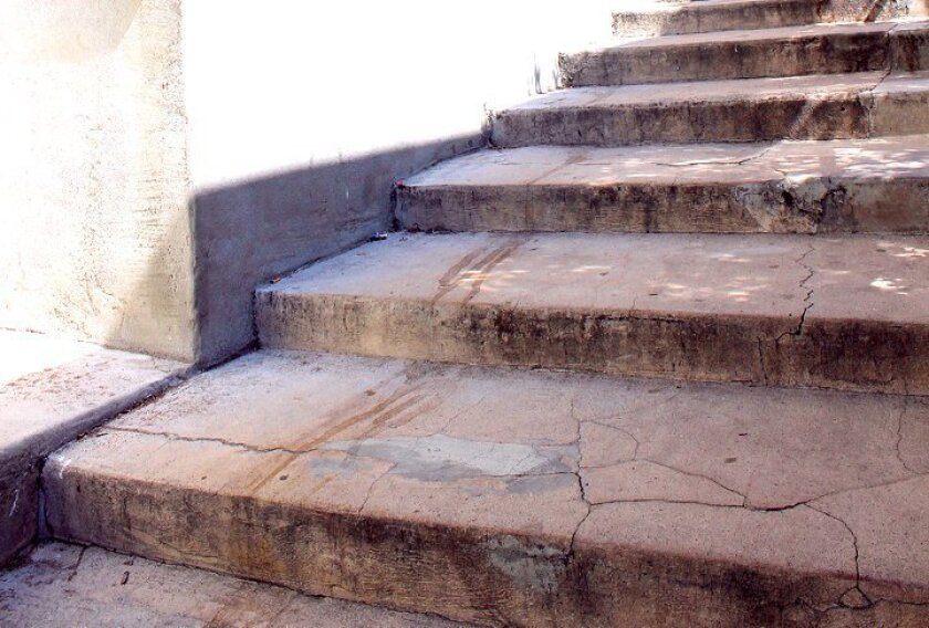 Liza and Paul Breuninger say they have been urging the city to repair and maintain the cracked steps descending from Prospect Street to Coast Boulevard South in La Jolla for several years, though to date only minor patchwork has been completed — in 2013.