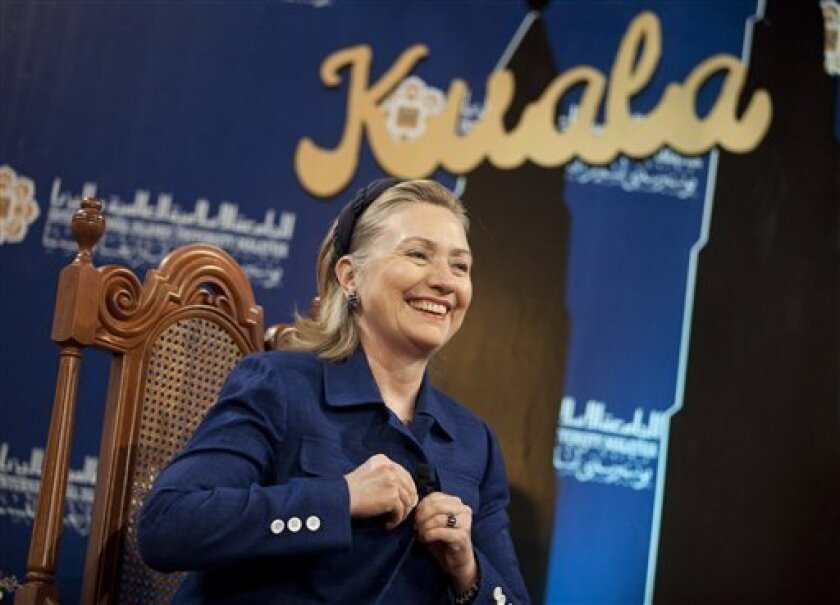 U.S. Secretary of State Hillary Rodham Clinton smiles before the start of a town hall event at the International Institute of Islamic Thought and Civilization on Tuesday, Nov. 2, 2010, in Kuala Lumpur, Malaysia. (AP Photo/Evan Vucci, Pool)
