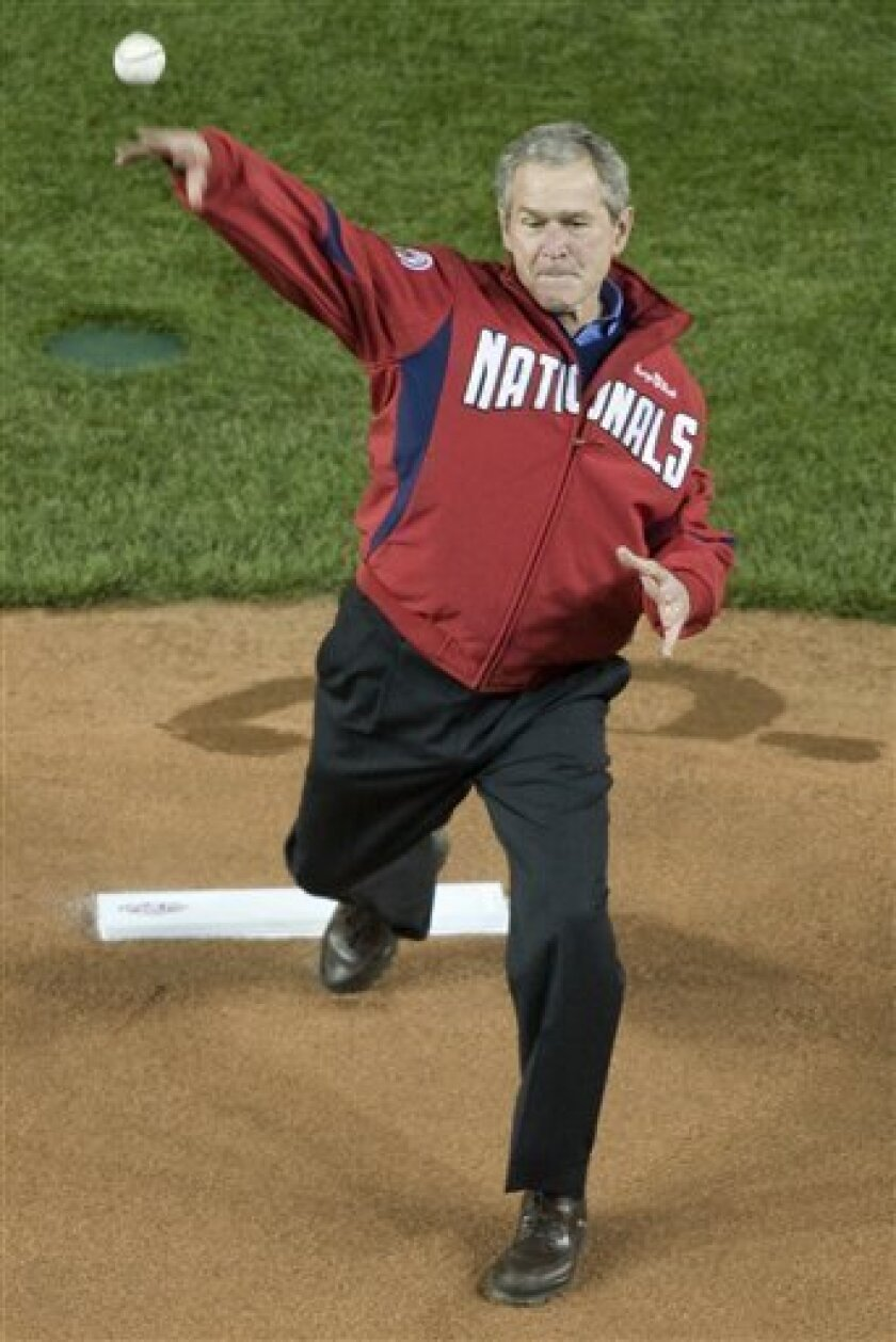 President Bush throws out the ceremonial first pitch before the home opener for the Nationals in their new ballpark Sunday, March 30, 2008 in Washington. The Nationals face the Atlanta Braves in the first game of the season. (AP Photo/J. David Ake)
