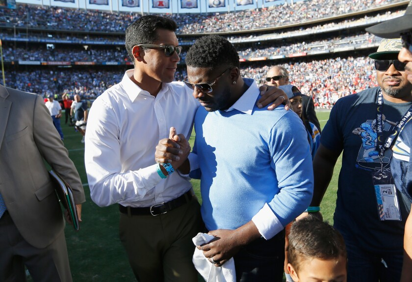 Donnie Edwards, left, and LaDanian Tomlinson,