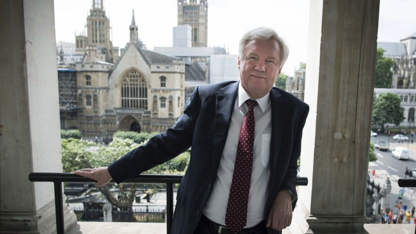 Britain's former chief Brexit negotiator David Davis poses in the Houses of Parliament in Westminste