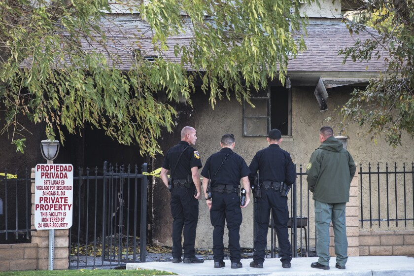 Law enforcement officials investigate the scene of suspected arson at the Islamic Society of the Coachella Valley on Friday.