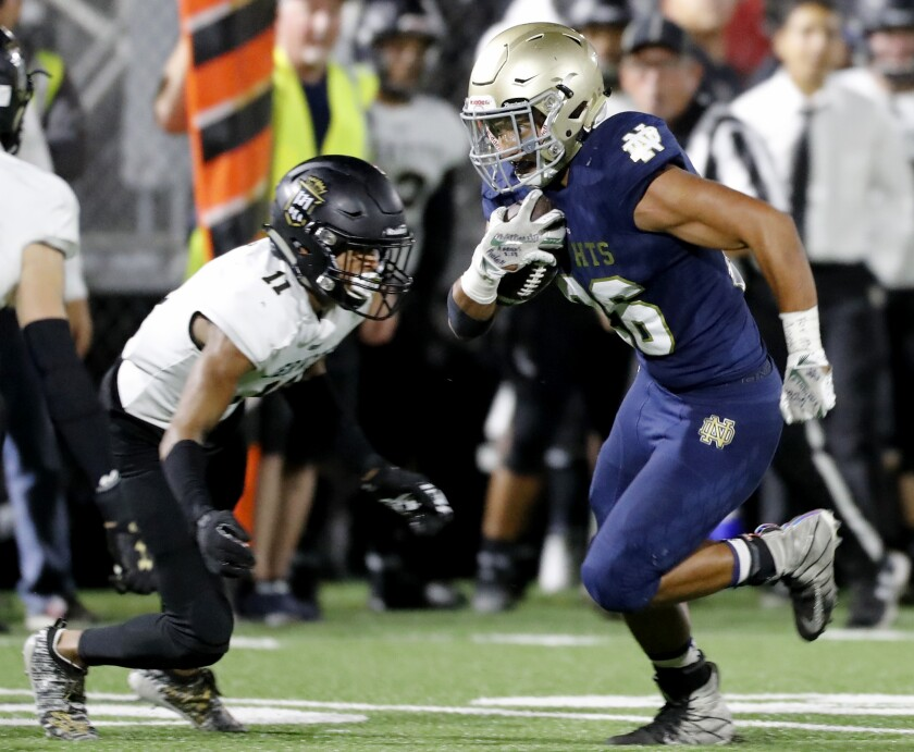 Notre Dame running back Anthony Spearman cuts upfield against Servite defensive back Noah Avinger in the first quarter in Sherman Oaks on Friday.