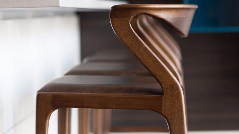 5. Sossego's ergonomic Brazilian Duda stools look as great as they feel.