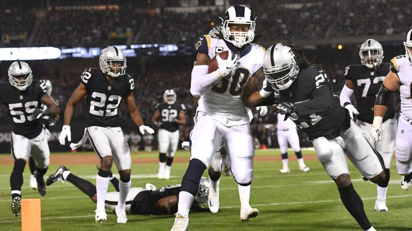 OAKLAND, CALIFORNIA SEPTEMBER 10, 2018-Rams running back Todd Gurley beats the Raiders defense to th