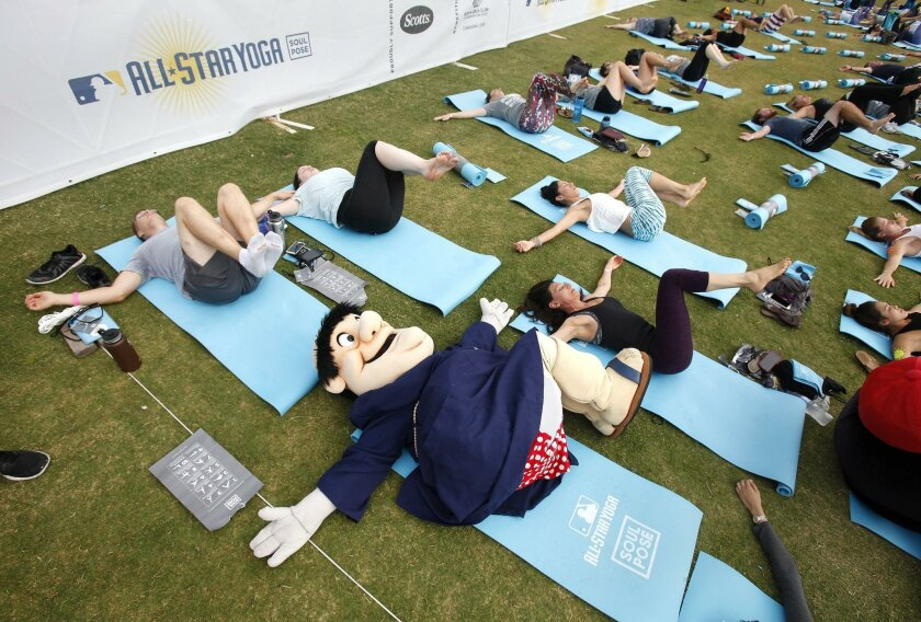 Even the San Diego Padres' Swinging Friar got loose at Saturday's yoga session at Waterfront Park.