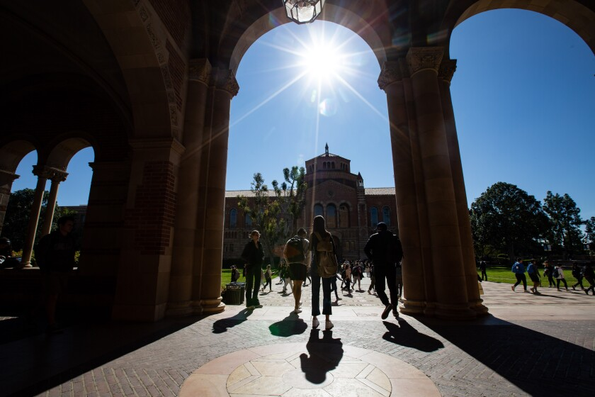 Students depart Royce Hall on the campus of UCLA