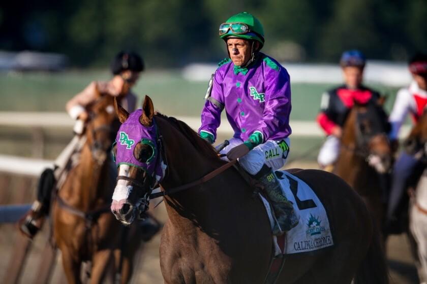 El jinete mexicano Víctor Espinoza sobre el caballo California Chrome.