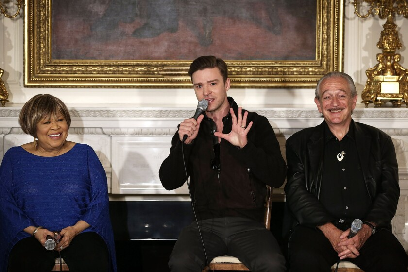 """Justin Timberlake, center, speaks as Mavis Staples and Charlie Musselwhite listen during an interactive student workshop, """"Soulsville, USA: The History of Memphis Soul,"""" at the White House in Washington, D.C., on April 9, 2013."""