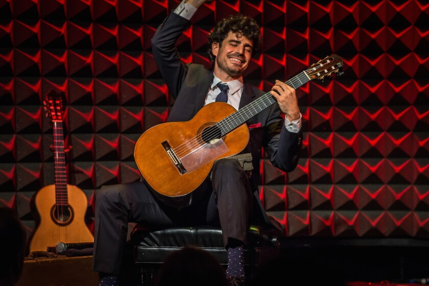 Guitarist Pablo Sáinz Villegas, the La Jolla Music Society's first education ambassador in residence, was clearly distracted by the unwrapping of candy by a concertgoer at his Saturday night performance at the Baker-Baum Concert Hall at La Jolla's new Conrad Prebys Performing Arts Center. He is shown above at a concert in New York City.