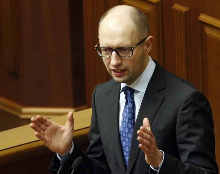 Ukraine's interim prime minister, Arseny Yatsenyuk, gives a speech at the Ukrainian Parliament in Kiev