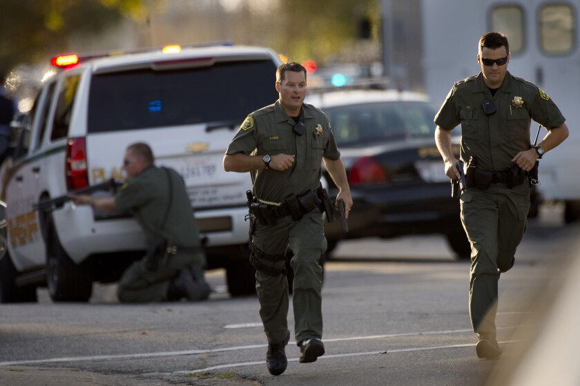 Police converge on a house where the suspect in a shooting of an ICE agent and a police officer is holed up.